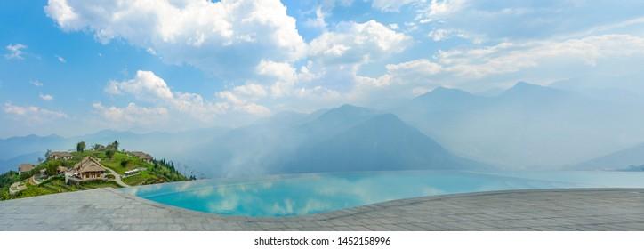 Panorama of Sapa Vietnam, Infinity Pool with mountain view, Pool Terrace and Mountain View, Infinity Swimming Pool View on mountain with clouds and blue sky