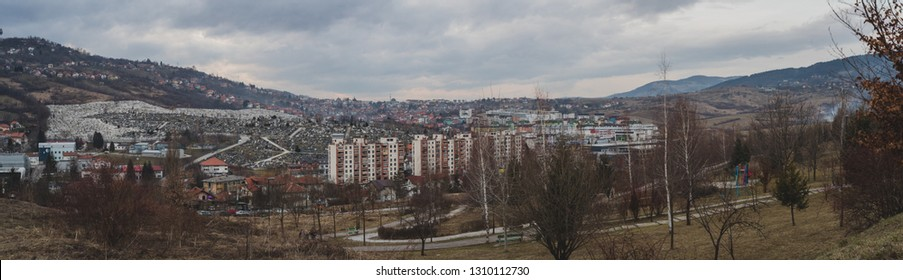 Panorama of Sarajevo up on the hills. View of a war graveyard up on the bosnian hills above Sarajevo. Panorama of a cemetery in sarajevo