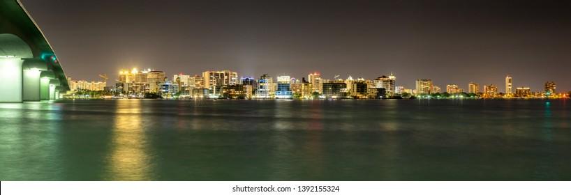 Panorama of Sarasota skyline taken at night.  Shows portion of John Ringling Causeway leading over Sarasota Bay and into the city.