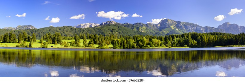 Panorama scene in Bavaria, Germany, with alps mountains and lake at spring