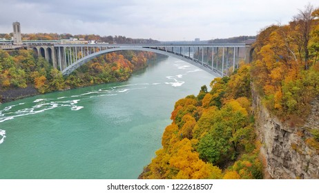 Panorama scenery of Niagara river and bridge at Niagara Falls State park, border of USA and Canada in Autumn in New York state, USA. Defocus picture.