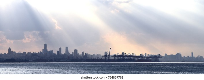 Panorama of the sea and Beirut shipping Harbour, new Beirut quarter extended over the sea and the  skyline of Beirut city in Backgroud enlighted by rays of sunlight
