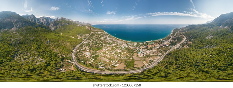 Panorama of the sea and mountain landscape with a serpentine road near the village of Kemer, Turkey. Aerial view