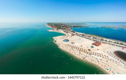Panorama of sea shore in Berdyansk, South Ukraine, Europe. Resort city with nice sand beach and clear blue sea. Famous travel destination, ideal place for comfort vacation on Azov Sea. Drone photo