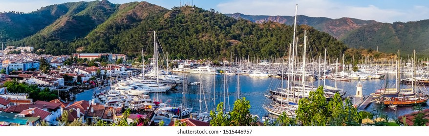 Panorama sea view sailboats Turkey mountain City port Marmaris holiday vacation background concept. Marmaris old town Lighthouse sea view Turkey mountain.