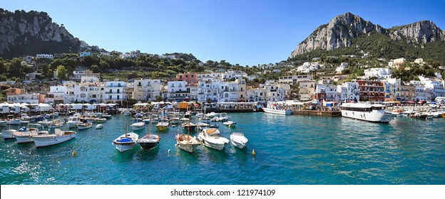 Panorama of seaport Marina Grande, Capri island - Italy. Image assembled from four horizontal frames