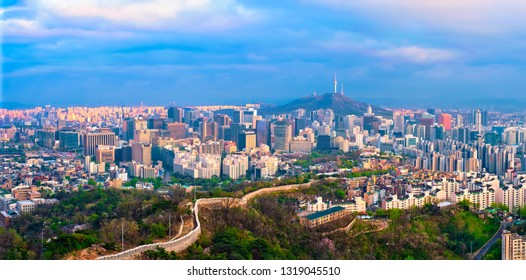 Panorama of Seoul downtown cityscape and Namsan Seoul Tower on sunset from Inwang mountain. Seoul, South Korea.