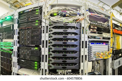 Panorama of the server room of the data center. A lot of powerful supercomputers working