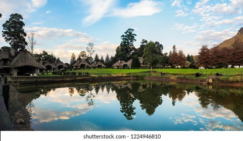 Panorama shot of beautiful hill area with calm smooth lake with mirrow effect, perfect for vacation