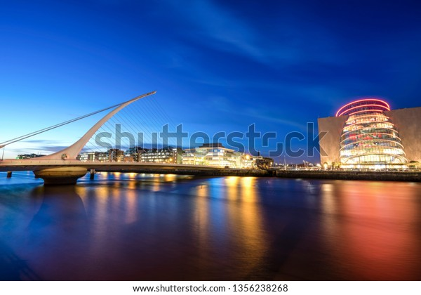 Panorama shot of the Samuel Beckett Bridge in Dublin, Ireland at sunset with the Convention Centre on the right side