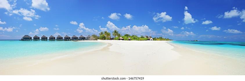 Panorama shot of a tropical island on Lhaviyani atoll, Maldives on a sunny day