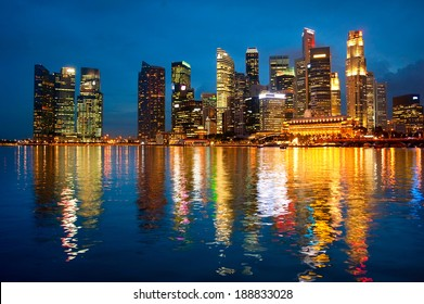 Panorama of Singapore downtown with reflection in a river