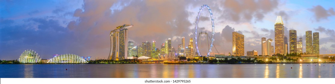 Panorama of Singapore Marina Bay at beautiful twilight with reflection in a river