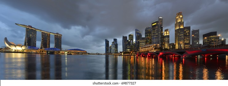 Panorama of Singapore river and skyline at blue hour