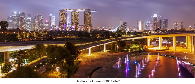Panorama of Singapore skyline illumintaed in the evening twilight
