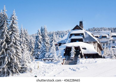 Panorama of ski resort, ski slope, chalet houses covered with snow