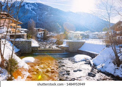 Panorama of ski resort town Mayrhofen and Ziller River in Tyrol in Zillertal valley in Austria, winter Alps. Landscape and cityscape with Alpine mountains with white snow. View from Penken park
