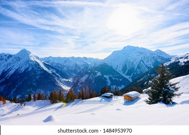 Panorama of ski resort town Mayrhofen with chalet houses in Tyrol in Zillertal valley in Austria in winter Alps. Landscape and cityscape with Alpine mountains with white snow. View from Penken park