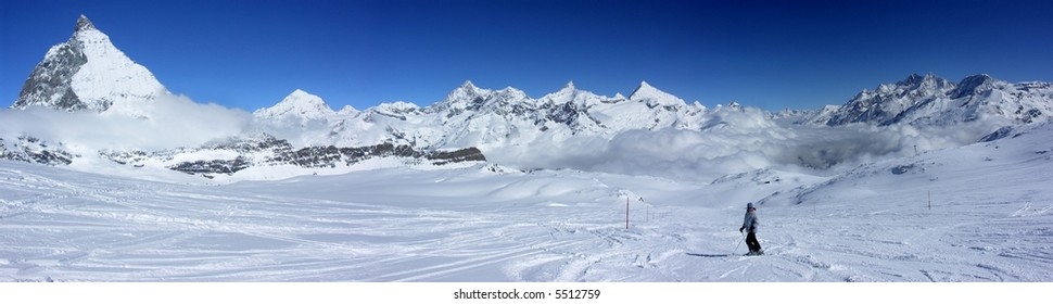 Panorama of ski slopes under Matterhorn rock