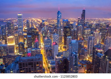 Panorama skyline and cityscape of Windy city of Chicago, in USA, Aerial view of downtown during twilight hours after sunset