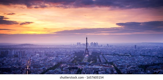 panorama of skyline of Paris with Eiffel Tower at sunset in Paris, France. Eiffel Tower is one of the most iconic landmarks of Paris.