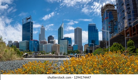 Panorama of skyline Perth downtown seen from Elizabeth Quay with colorful flowers in foreground