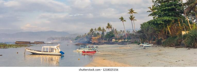 Panorama of small boats at the coast of Candidasa, Bali, Indonesia