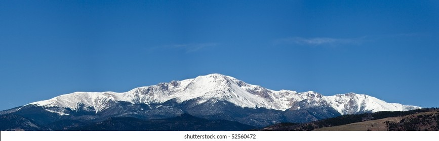 Panorama of snow covered Pikes Peak near Colorado Springs Colorado