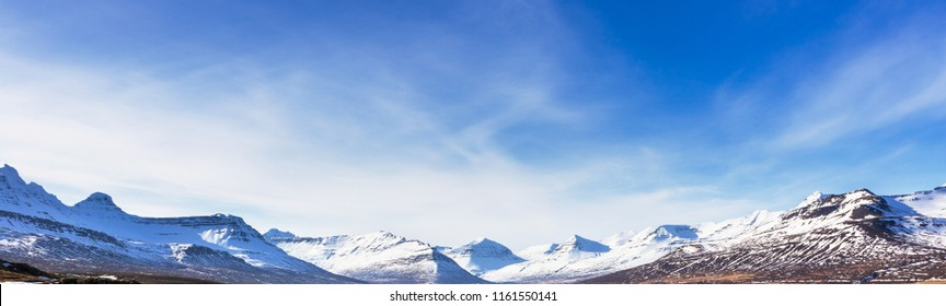Panorama of snow mountain landscape background with blue sky in  Iceland