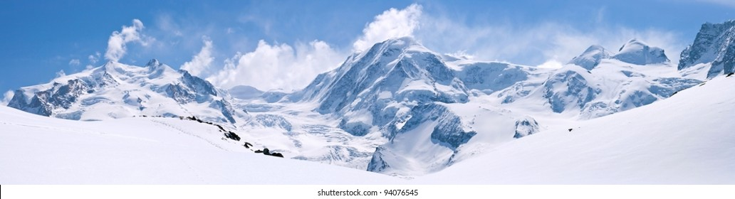 Panorama of Snow Mountain Range Landscape with Blue Sky at Matterhorn Peak Alps Region Switzerland