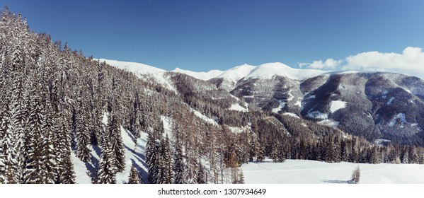 Panorama of the snow-covered mountain range in the southern Alps of Austria, Carynthia, in February 2019