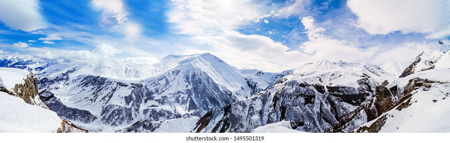 Panorama of snowy mountains. Caucasus mountains, Georgia, view from Gudauri ski resort.