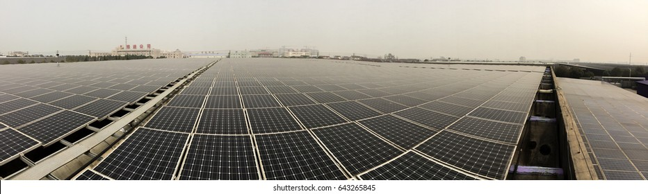 Panorama of solar panel rooftop to save the world from climate change due to global warming
