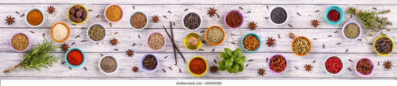 Panorama of spices and herbs on a wooden background