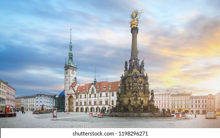 Panorama of the Square and the Holy Trinity Column enlisted in the Unesco world heritage list and Astronomical clock in the building of the Town Hall in Olomouc, Czech Republic at sunset
