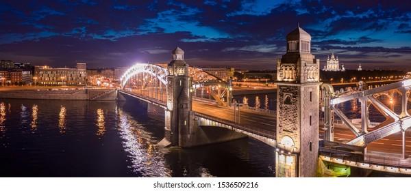 Panorama of St. Petersburg in the evening. Russia. Bolsheokhtinsky bridge. Peter the Great bridge with lighting. Bridges Of St. Petersburg. Rivers Of St. Petersburg. Neva. trip to Russia.