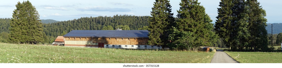 Panorama of stable and road in rural area of Switzerland