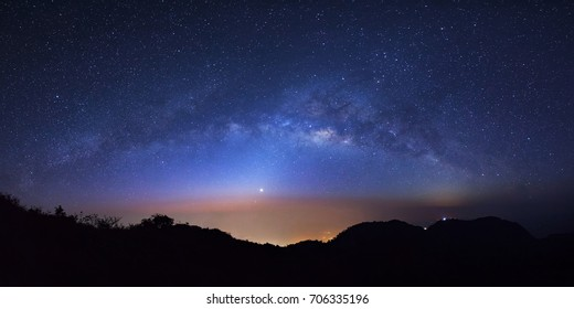 Panorama starry night sky with high moutain at Doi Luang Chiang Dao and milky way galaxy with stars and space dust in the universe