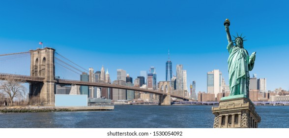 Panorama Statue of liberty with New York background of Brooklyn bridge and lower manhattan skyscrapers bulding in New York State NY , USA