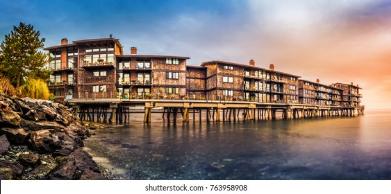 Panorama with stilt houses in West Seattle neighborhood at sunset