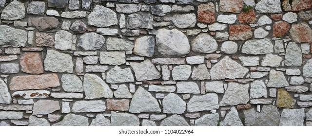 panorama stone wall with rough granite blocks