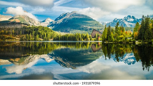 Panorama of Strbske pleso lake during autumn with colorful trees and beautiful reflection