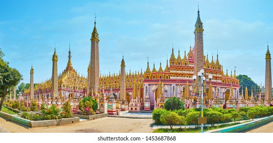 Panorama of stunning Thanboddhay Pagoda with complex carved details, gilt stupas, floral patterns, Monywa, Myanmar