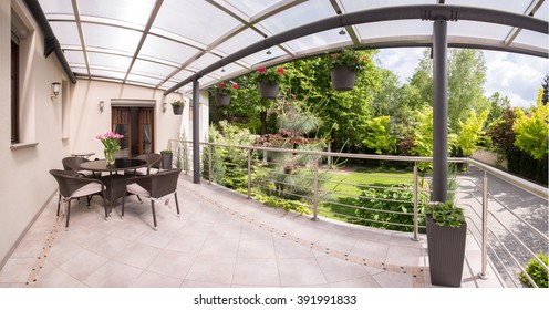 Panorama of stylish terrace and beauty garden