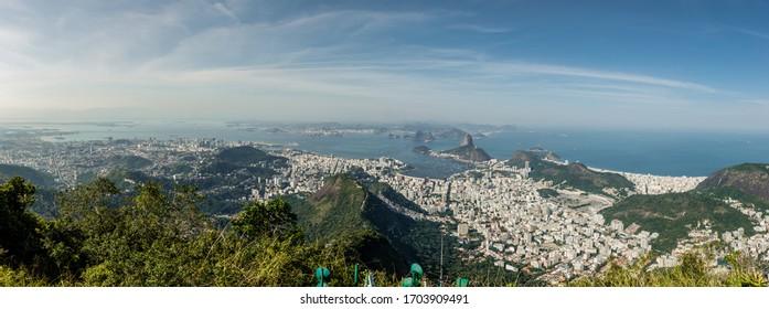 Panorama sugar Loaf and Botafogo beach view from Corcovado mountain in Rio de Janeiro, Brazil.