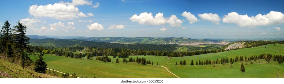 Panorama of Suitzerland Jura seen from Tete de Run, Chaux-de-Fonds town seen at right