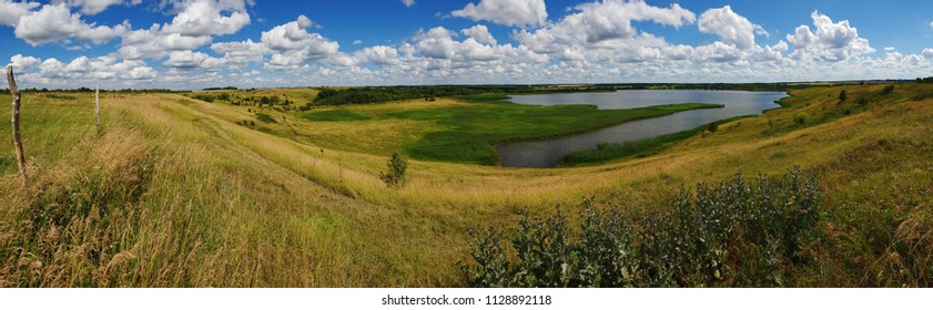 Panorama of summer landscape with pond in Russia