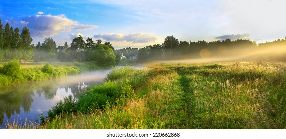 the panorama of a summer landscape with sunrise, fog and the river