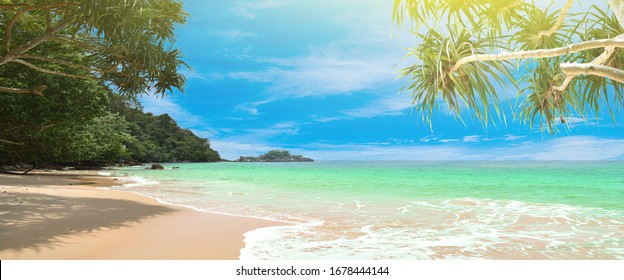 Panorama summer on the beach in Thailand.blue sky and white clouds. Freshness of the new day. Bright blue background. Relaxing feeling like being in the sky.Coconut trees on the beach.sand and sea.