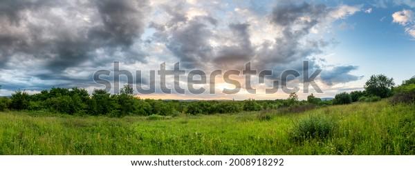 panorama-summer-sunset-before-storm-600w